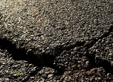 Signs That Your Commercial Asphalt Parking Lot Needs Repairs
